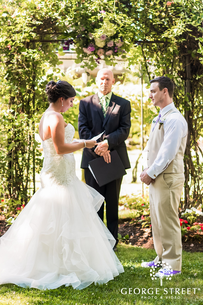 cute bride and groom exchange of vows
