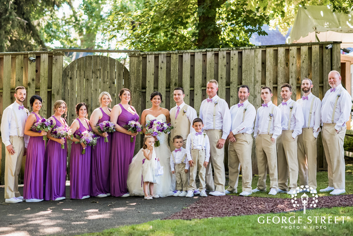happy couple with bridesmaid and groomsman