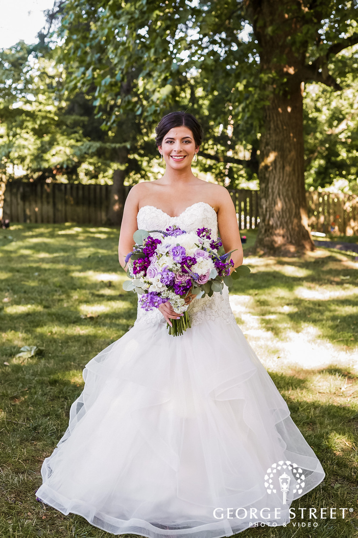 ravishing bride posing with bouquet