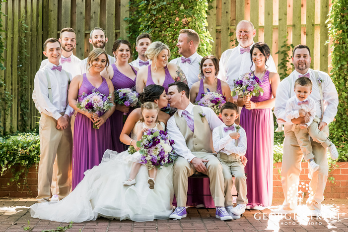 romantic couple with bridemaids and groomsmen
