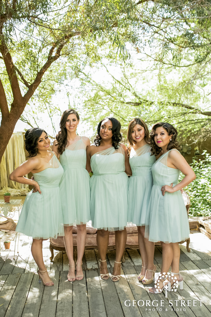 adorable bride and bridesmiads infront of barn at whispering tree ranch in phoenix wedding photo