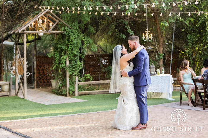 blissful bride and groom first dance in reception at whispering tree ranch in phoenix wedding photo