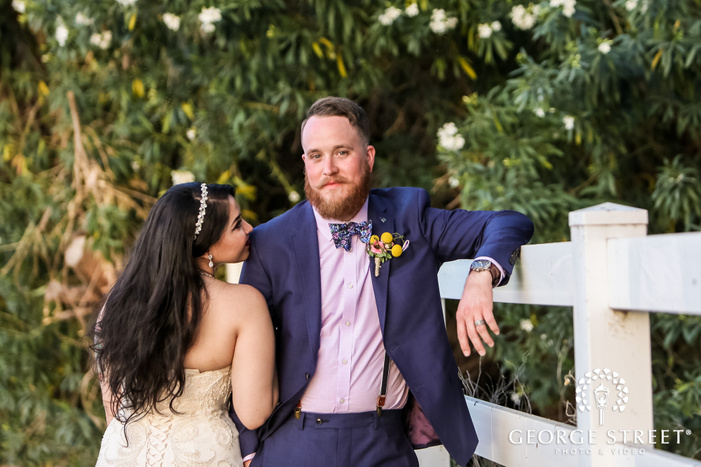 cute bride and groom in garden wedding photo