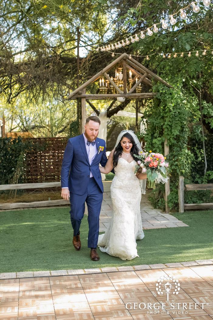 graceful bride and groom entrance in reception wedding photo