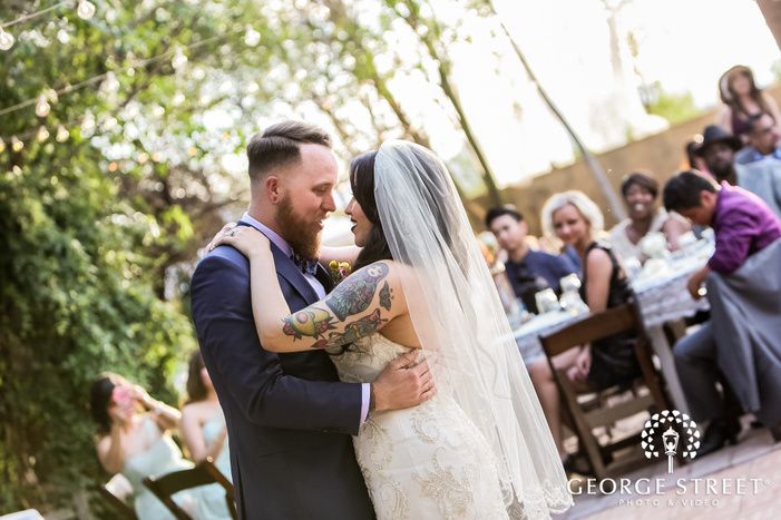 jolly bride and groom first dance in reception wedding photos