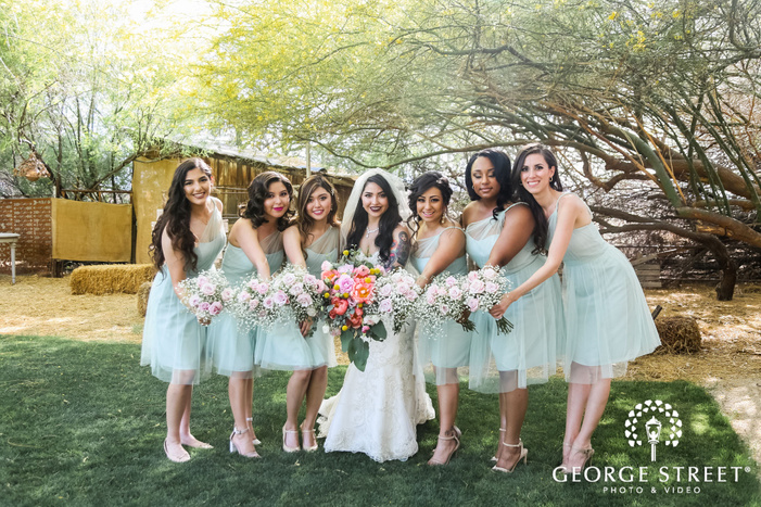 joyous bride and bridesmaids at back yard of wedding venue wedding photography