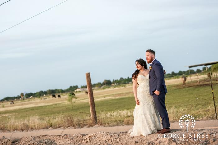 lovely bride and groom in green field near whispering tree ranch in phoenix wedding photos