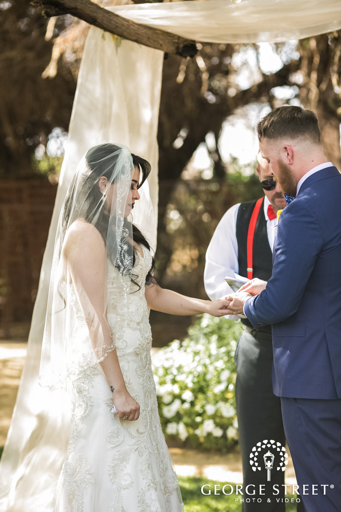 lovely bride and groom rings exchange at altar wedding photos