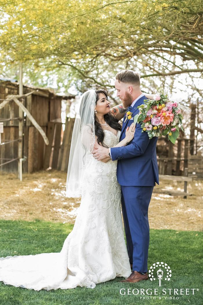 romantic bride and groom at backside of wedding venue wedding photography