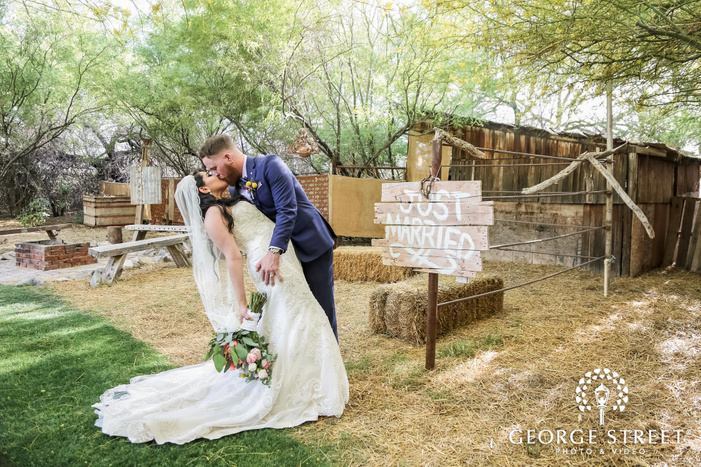 romantic bride and groom at backside of whispering tree garden wedding photography