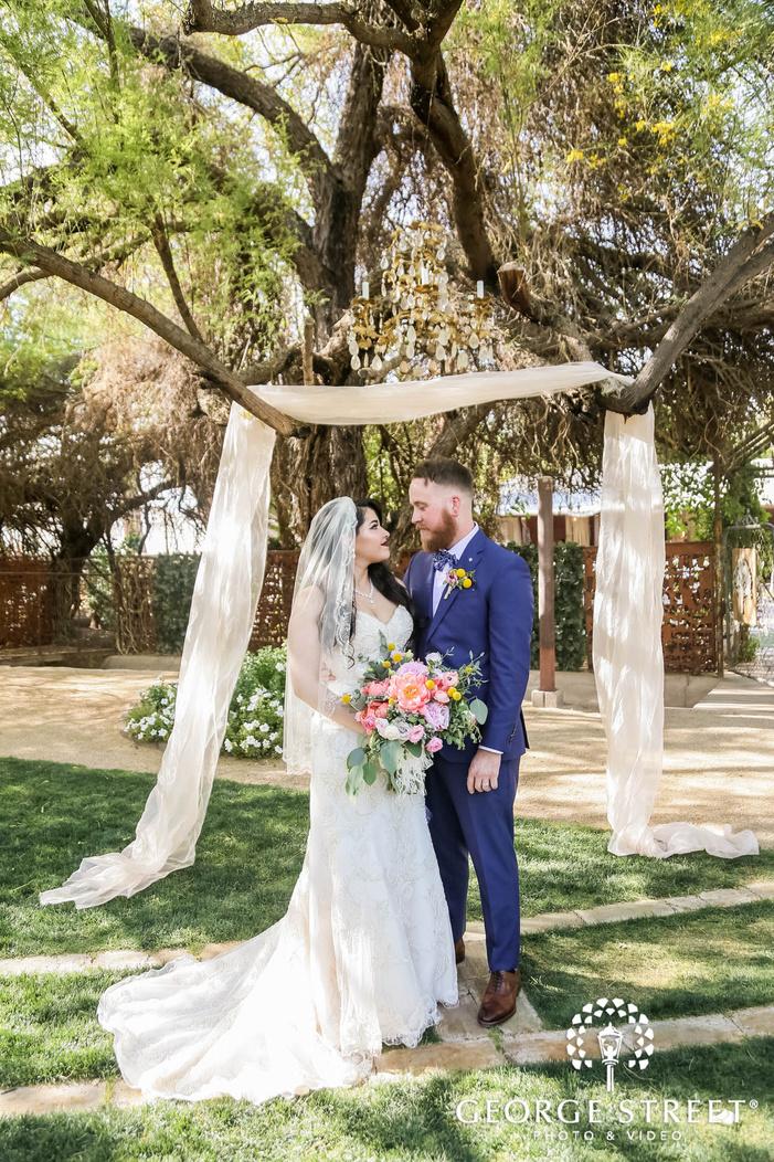 romantic bride and groom nea altar at whispering tree ranch in phoenix wedding photo