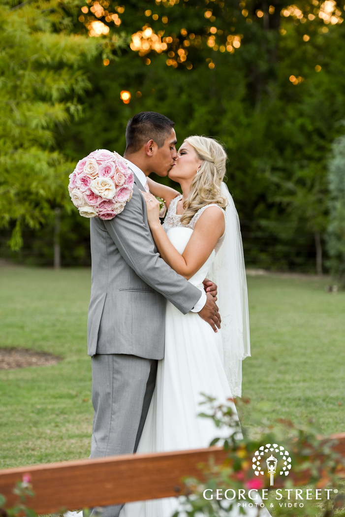 beautiful outdoor bride and groom kiss heritage springs dallas