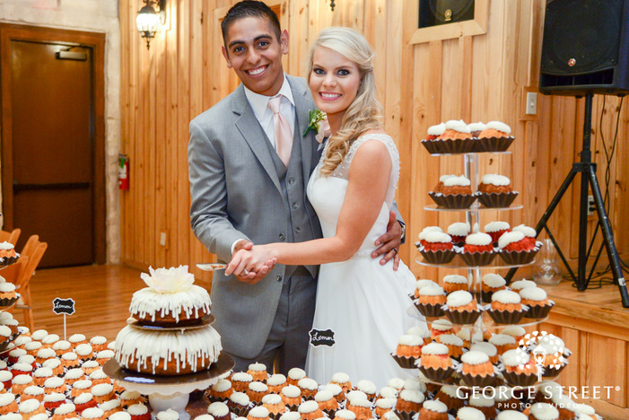 heritage springs wedding reception dallas bride and groom cake cutting