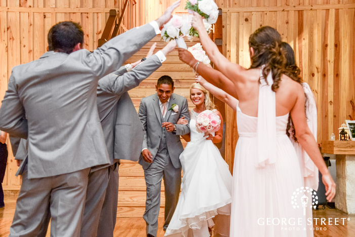 heritage springs wedding reception dallas bride and groom candid entrance