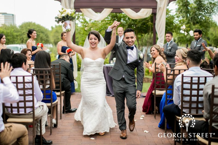 excited bride and groom at ceremony exit            s