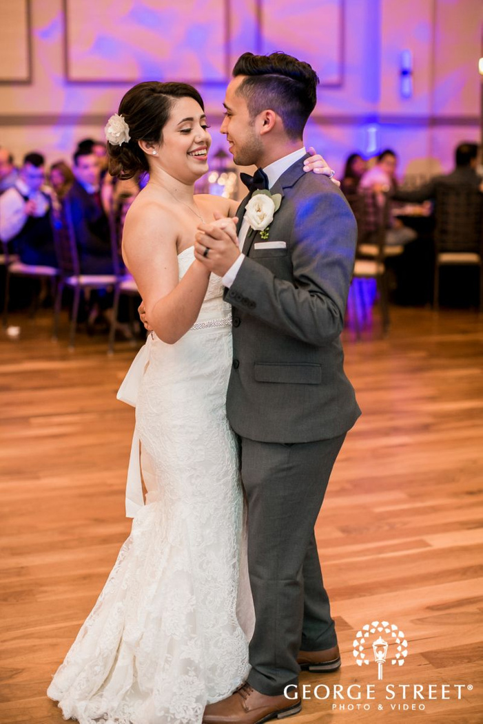 happy biride and groom reception dance             s
