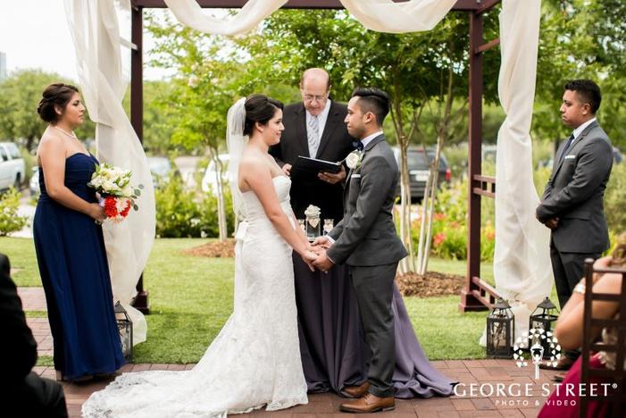 mesmerizing bride and goom at wedding ceremony            s