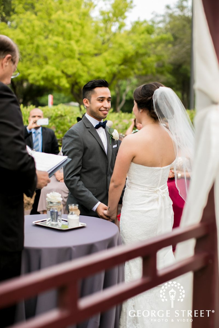 pretty bride and groom at wedding ceremony             s