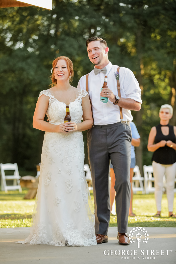 excited bride and groom at reception