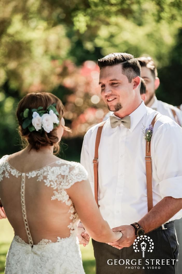 joyful bride and groom at wedding ceremony