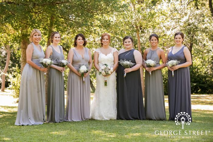 sweet bride and bridesmaids in garden