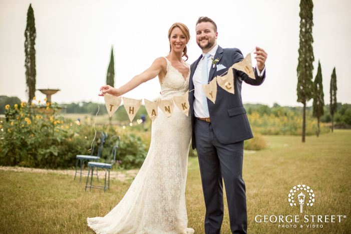 excited bride and groom in garden