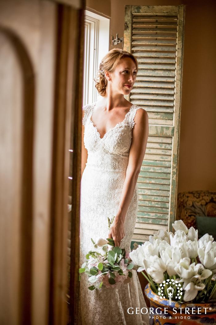 gorgeous bride holding bouquet wedding photos
