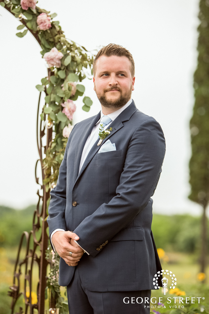 handsome groom first look to bride