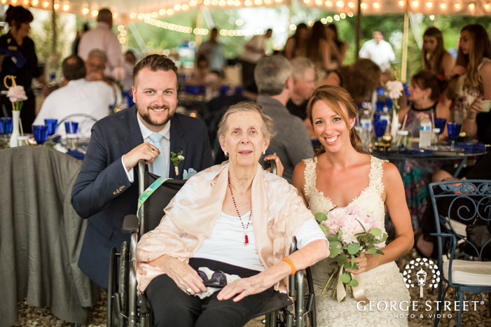 happy bride and groom with guest at reception