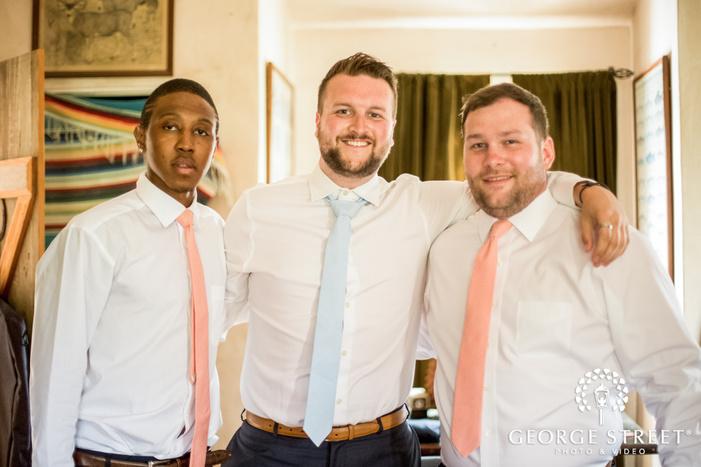 happy groom and groomsmen