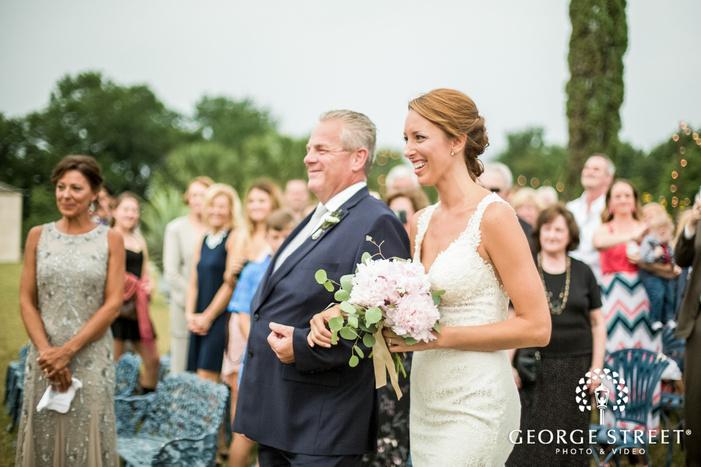 joyful bride and father at wedding ceremony entrance