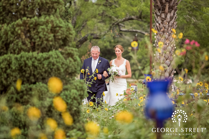 lovely bride and father walking down the aisle at le san michele in austin