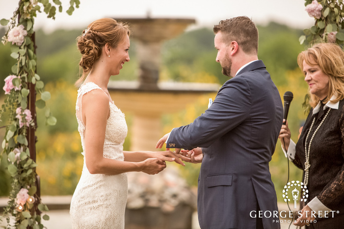 loving bride and groom at ring exchange ceremony