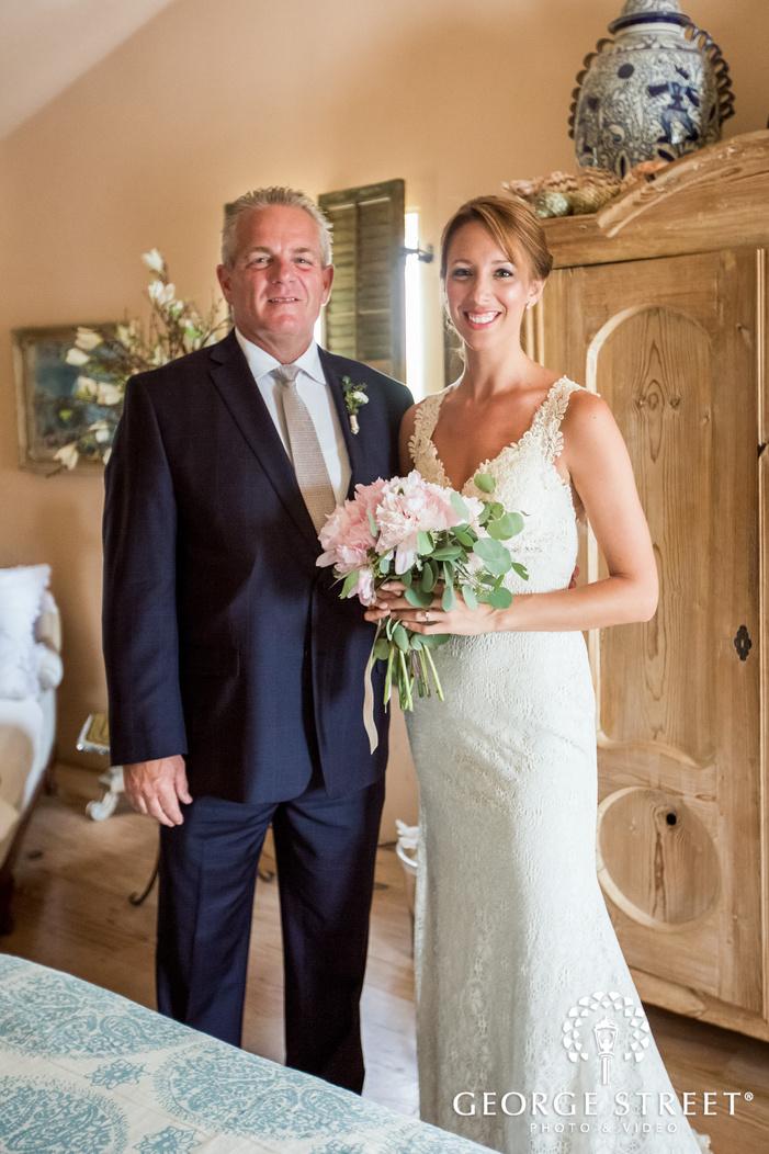 pretty bride and father in room