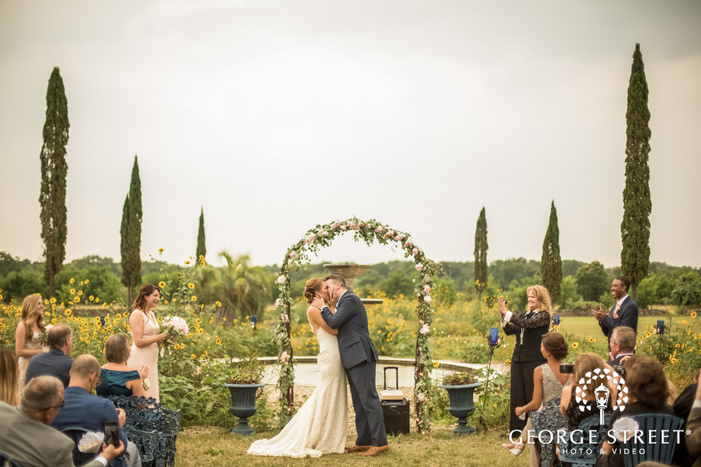 romantic bride and groom first kiss at le san michele in austin