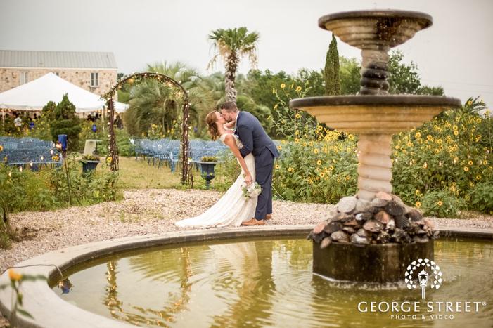 romantic bride and groom near fountain