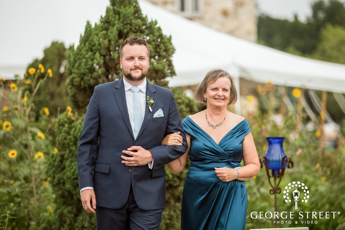 stunning groom and mother at ceremony entrance