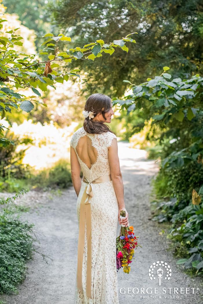 beautiful bride on grassy walkway wedding photography