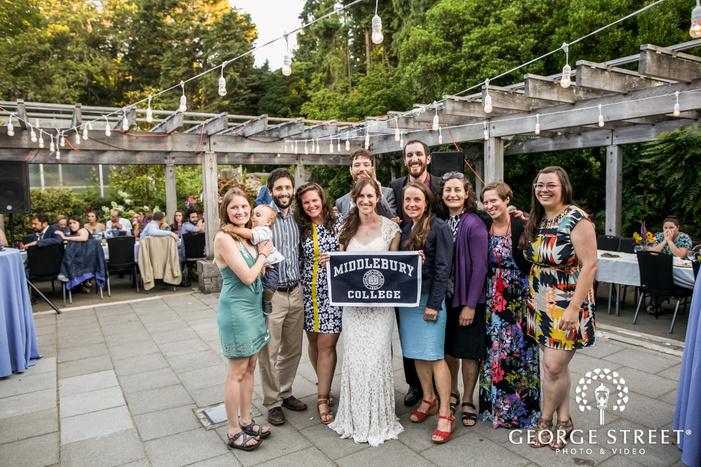 happy couple and guests on reception venue wedding photos