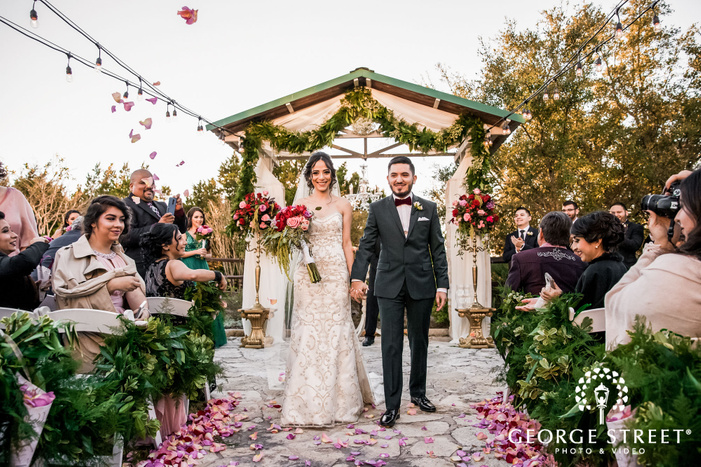 excited bride and groom at ceremony exit