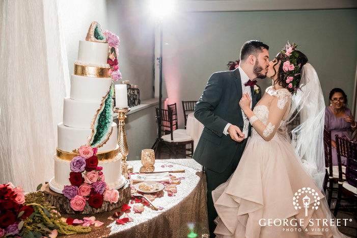 lovable bride and groom at cake cutting ceremony