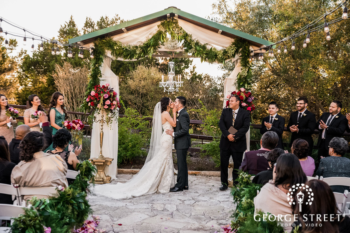 romantic bride and groom first kiss at the terrace club in austin