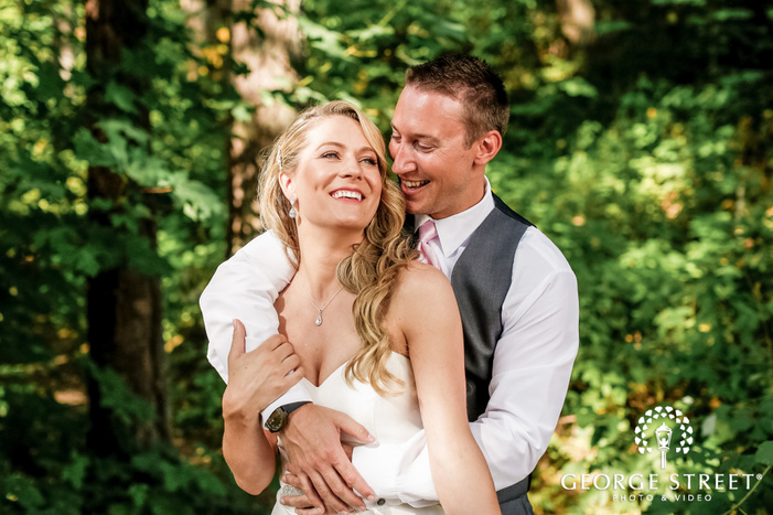 adorable bride and groom in green trees wedding photography