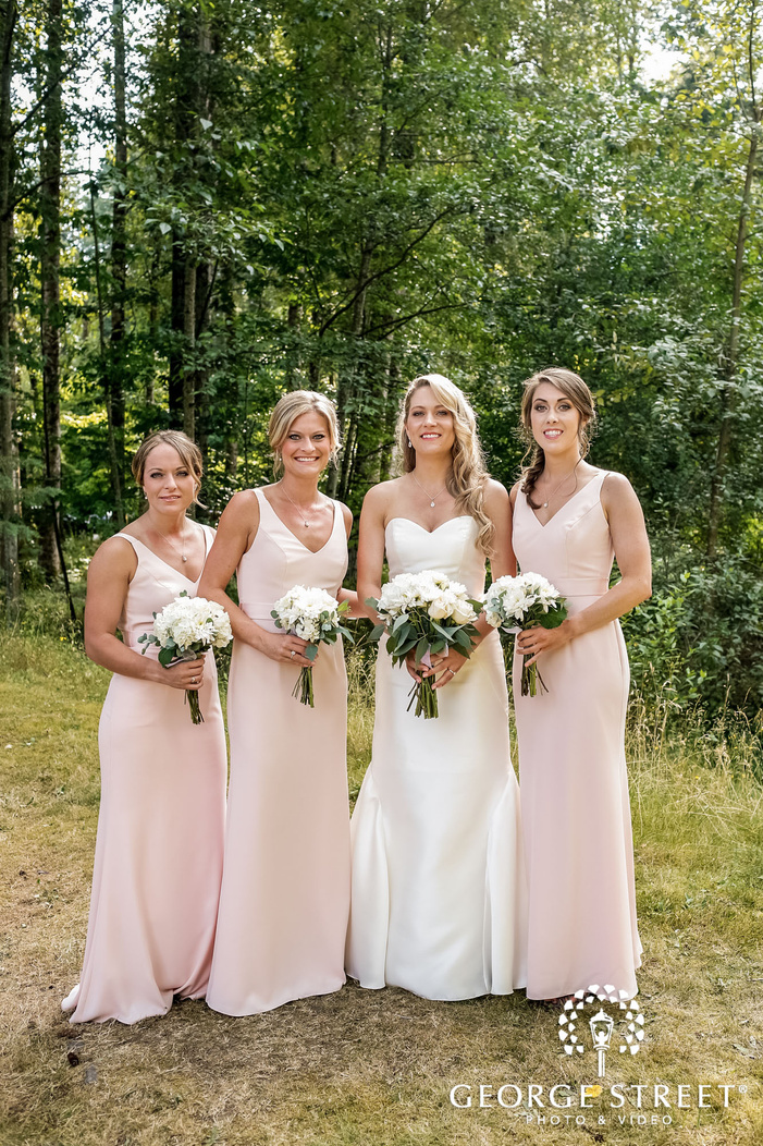 beautiful bride and bridesmaids in forest wedding photography