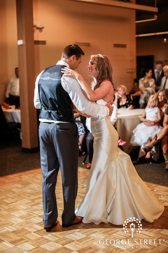 blissful bride and groom first dance at lake wilderness lodge in seattle