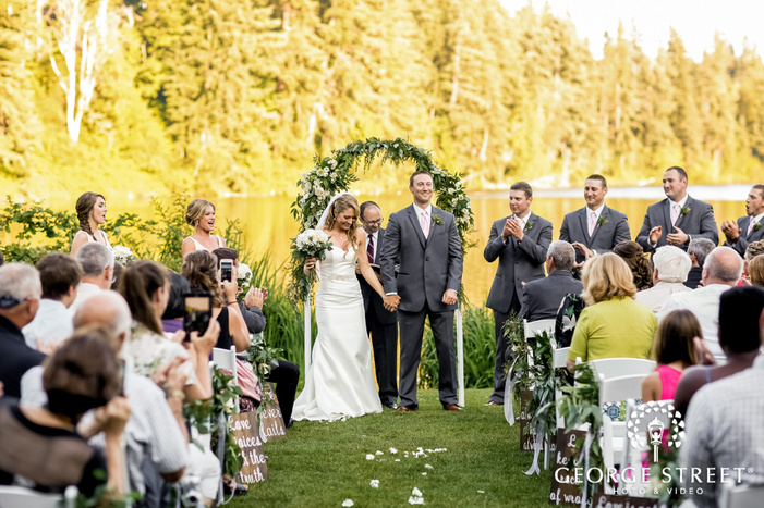 cheerful bride and groom ceremony exit wedding photos