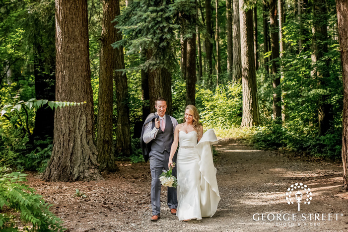 cute bride and groom in woods at lake wilderness lodge in seattle