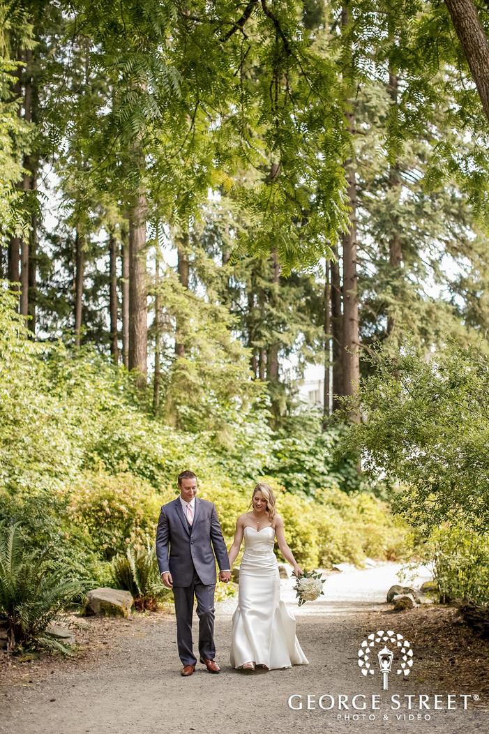 happy bride and groom on pathway wedding photography