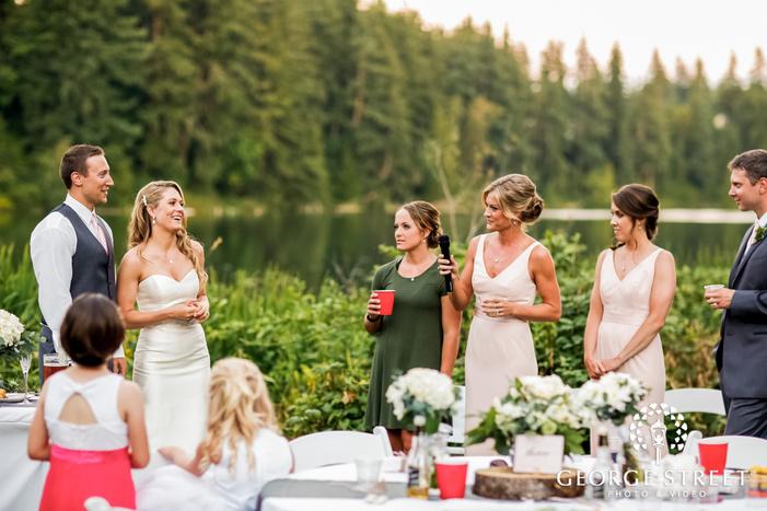joyous bride and groom during reception toast wedding photos