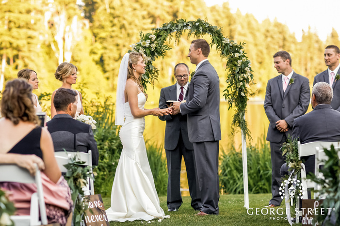 loving bride and groom ring exchange wedding photos